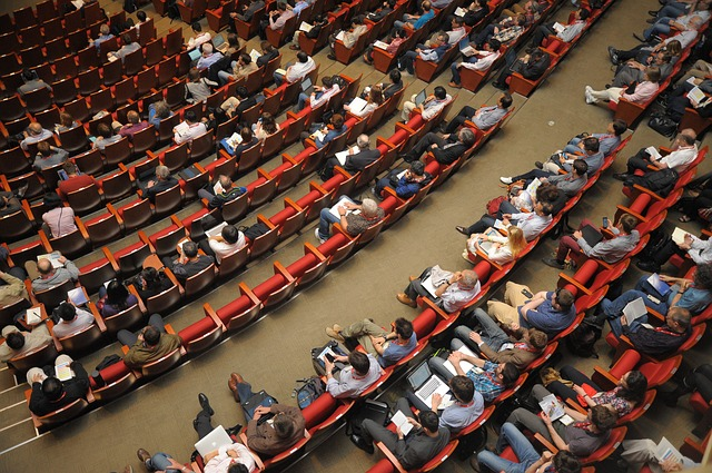 Photo of people in auditorium seats